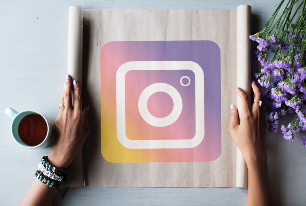 Instagram logo on table with flowers